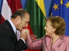 File photo of German Chancellor Merkel being kissed by then French President Chirac in Berlin